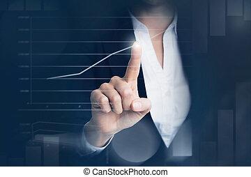 Business woman touching graph