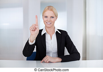 Business woman touching the screen with her finger
