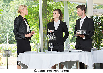 business woman training students in a restaurant