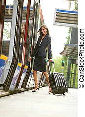 Business woman traveling by train