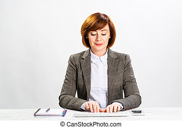 Business woman typing on computer keyboard
