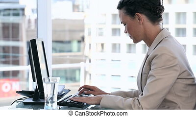Business woman using a computer - Video of a business woman...
