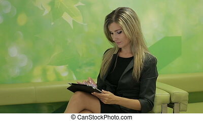 Business woman using a pad to search for business options and solutions