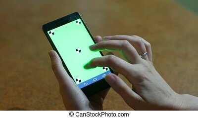Business woman using a Smart phone Touchscreen CHROMA KEY Close-up , Fingers make gestures touching and swiping the screen of a modern smartphone.