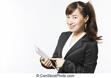 Business woman using a tablet pc on white background