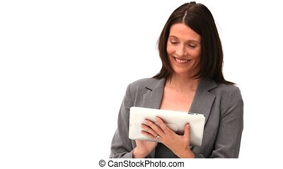 Business woman using a touch pad - Businesswoman using a...