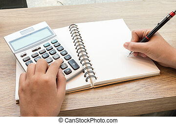 Business woman using calculator for calculating data