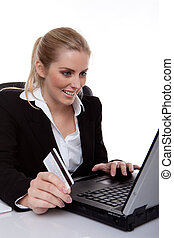 woman using laptop and card
