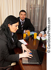 Business woman using laptop at meeting