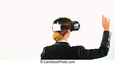 Business woman using virtual reality headset against white...