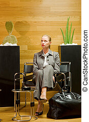 business woman waiting in office lobby