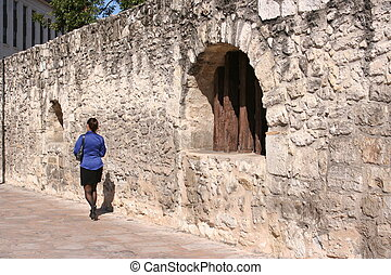 Business Woman Walking by the Alamo