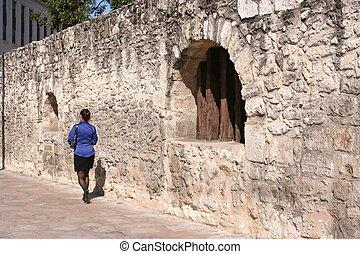Business Woman Walking by the Alamo
