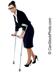 Business woman walking with help of crutches