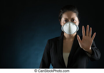 woman wearing a face mask to deal with virus