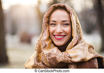 Smiling young and happy business woman wearing headscarf