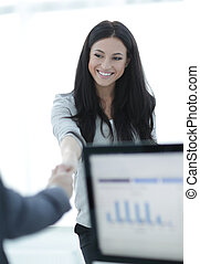 business woman welcomes colleague with handshake. photo with...