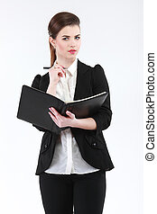 Business woman with a notebook and pen