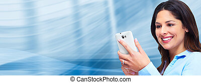 Business woman with a smartphone.