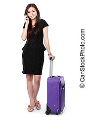 Business woman with a suitcase calling