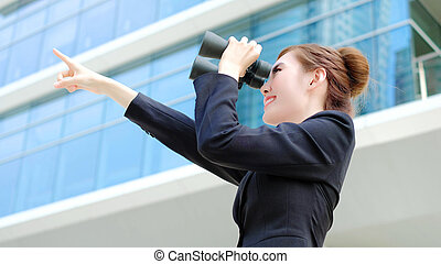 Business woman with binocular