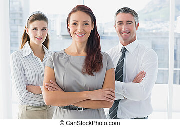 Business woman with colleagues - Smiling business woman with...