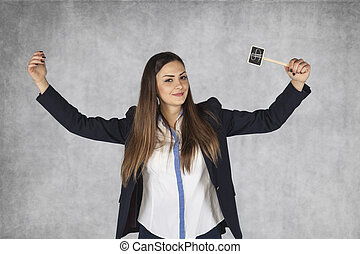 business woman with dollar signs raises her hands in a gesture of success