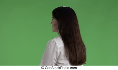 Business woman with folder for papers against a green screen close-up