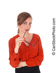 Business woman with glasses in mouth.