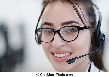 Business woman with headsets at work