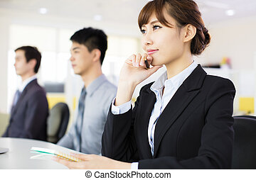 business woman with her staff in conference room