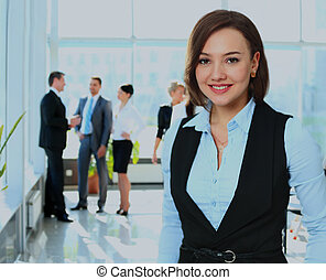 Business woman with her team at the office.