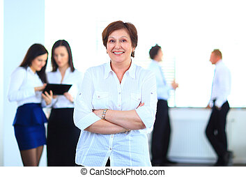 Business woman with her team at the office