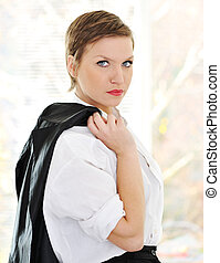 Business woman with jacket on shoulder