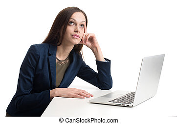 business woman with laptop daydreaming