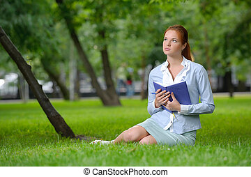 Business woman with notebook