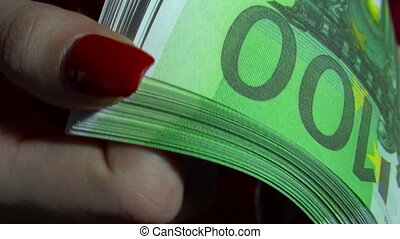 business woman with pack of money euro in hands