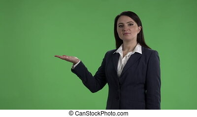 Business woman with presentation gesture against green screen