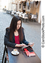 Business woman with tablet at coffee bar