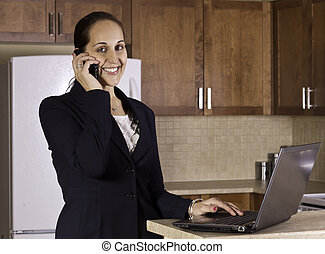 Business woman working from her kitchen