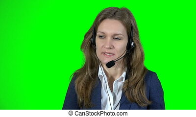business woman working in call center with headphones and microphone on green