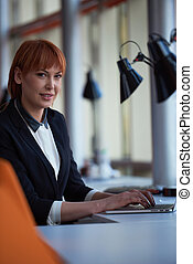 business woman working on computer at office
