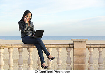 Business woman working outdoor on the phone