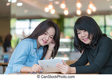 business woman working together with tablet at coffee shop