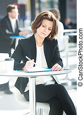 Business woman working with documents