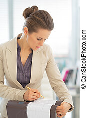 Business woman working with folder