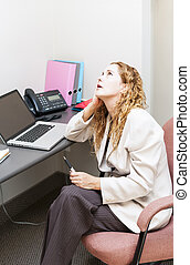 Business woman worried at office desk