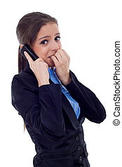 business woman worries on the phone - A business woman...