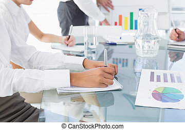 Business woman writing down notes