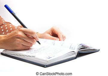 Woman Writing with pen in notepad